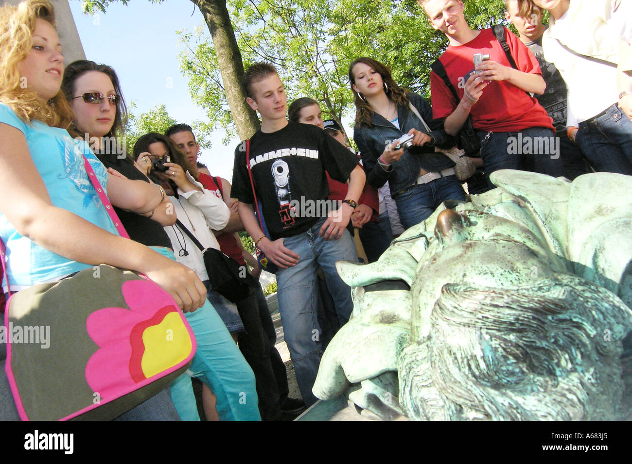 Group of teenage schoolchildren visiting Pere Lachaise cemetery Paris France - Stock Image