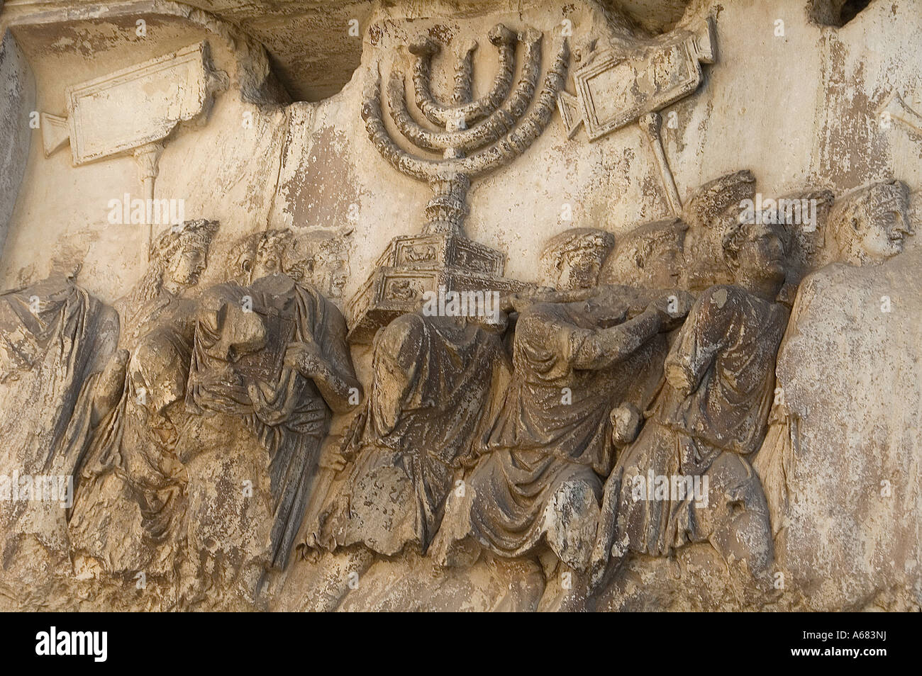 Relief depicting roman soldiers carrying spoils from Jerusalem temple on Titus arch at the ancient Roman forum site, - Stock Image