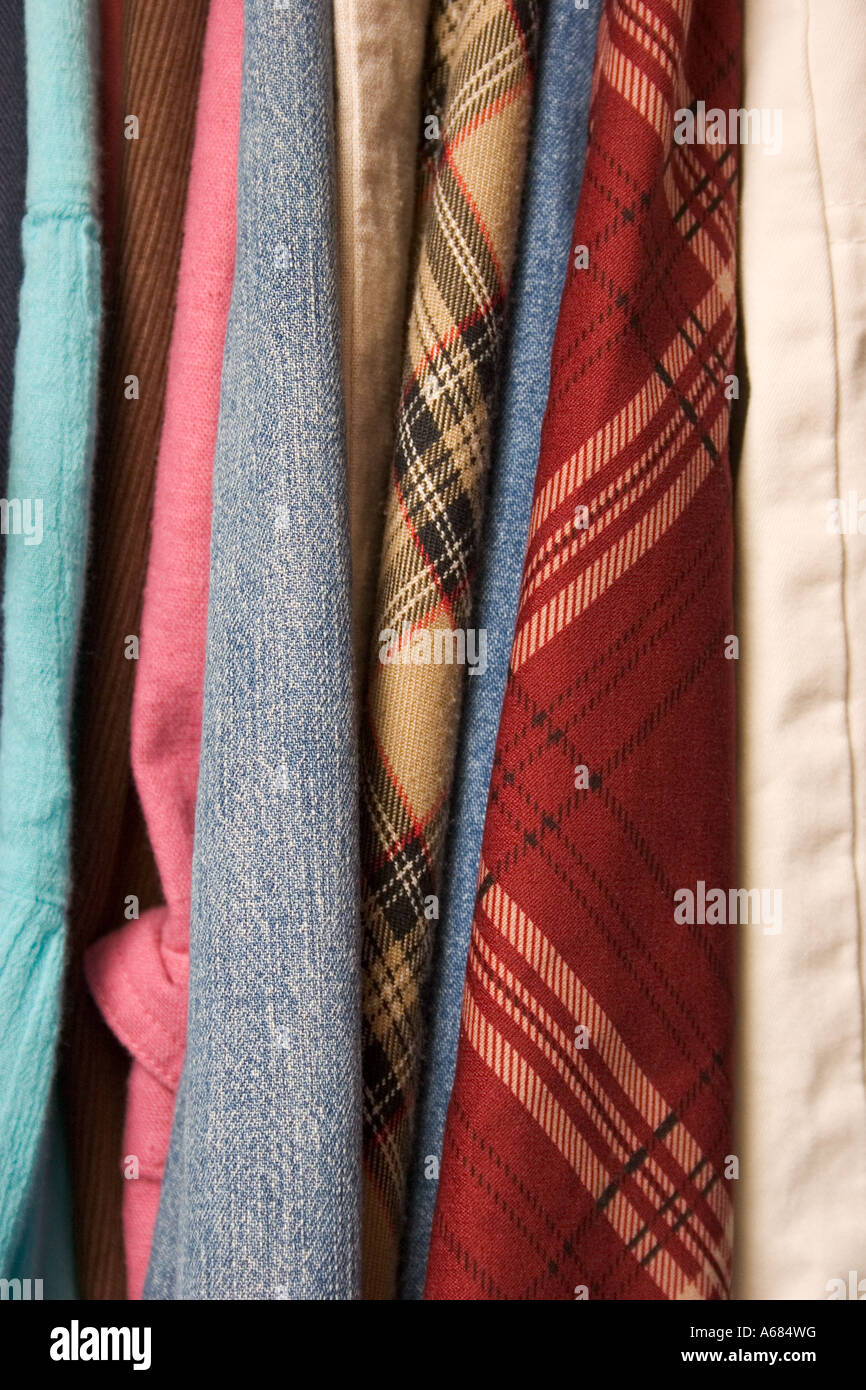 Plaid skirts in closet - Stock Image