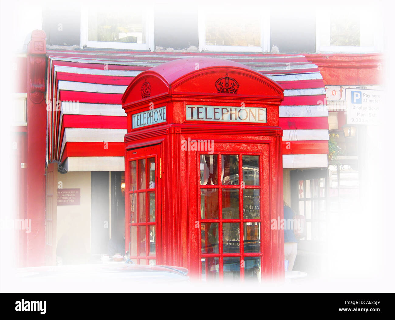 traditional red public phone box outside the Coffee Cup Cafe in London Hampstead England - Stock Image