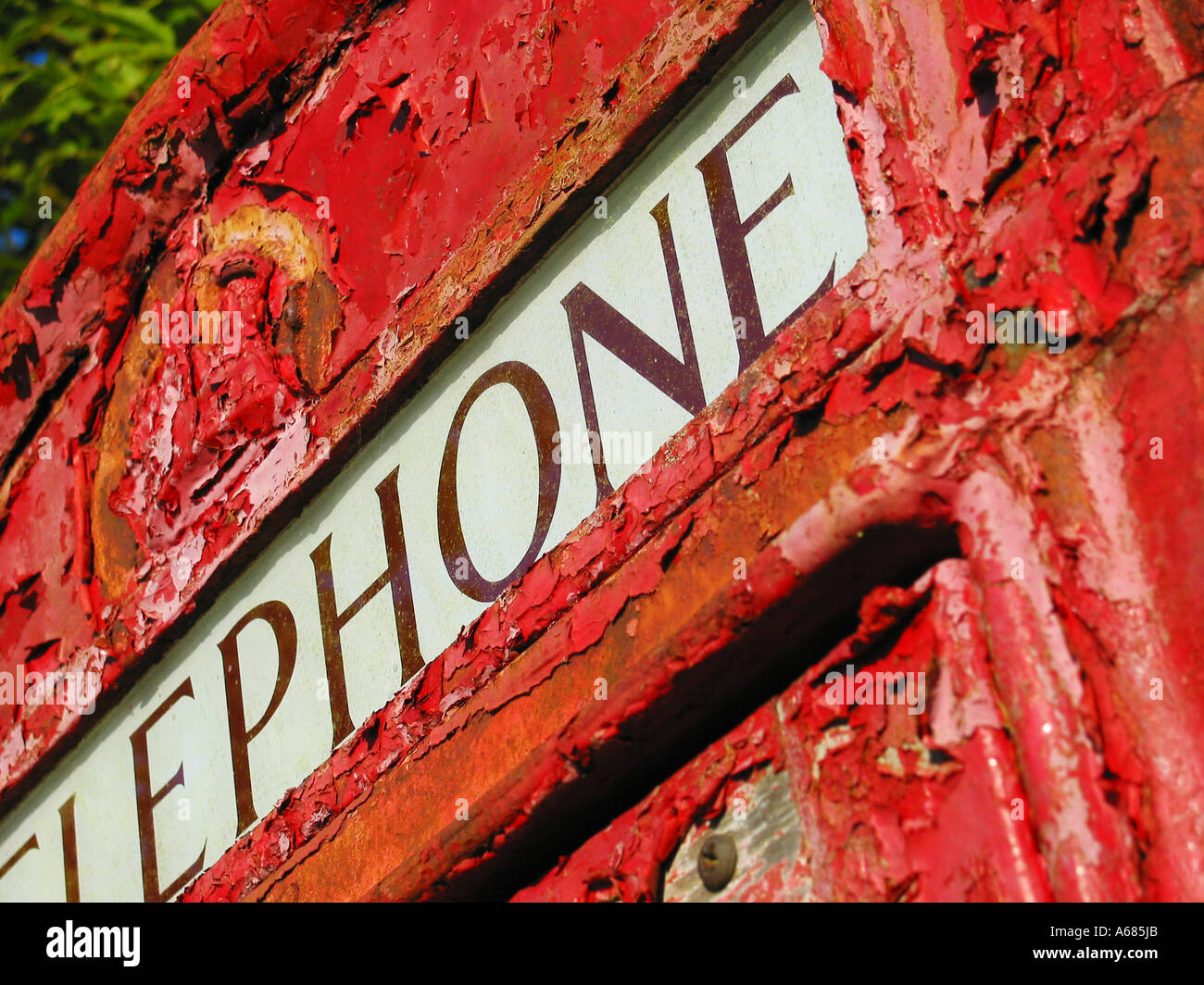 detail of old derelict red public phone box Glastonbury Somerset England - Stock Image