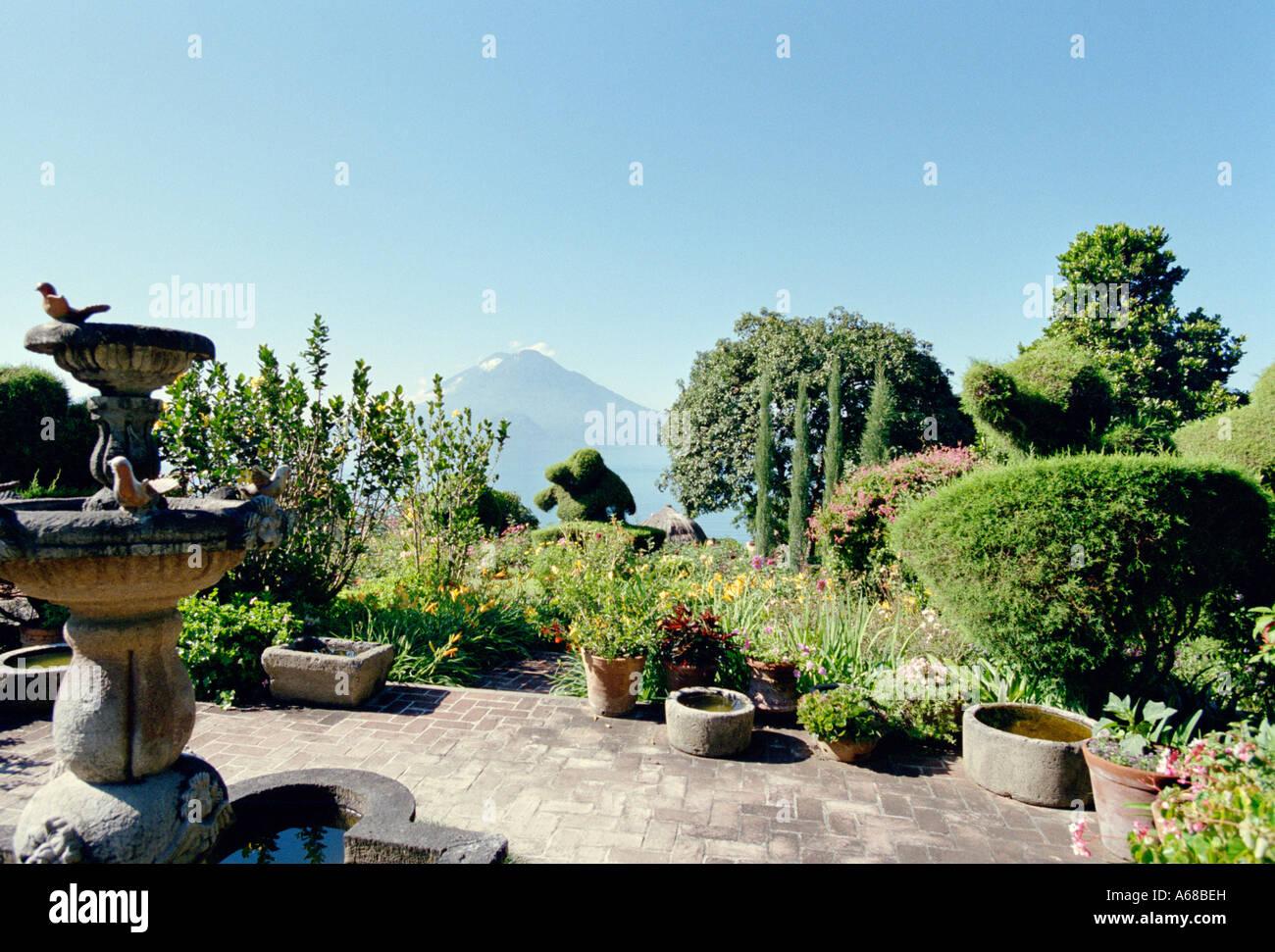 Gardens and lake at Hotel Atitlan, Santiago, Atitlan, Guatemala. - Stock Image