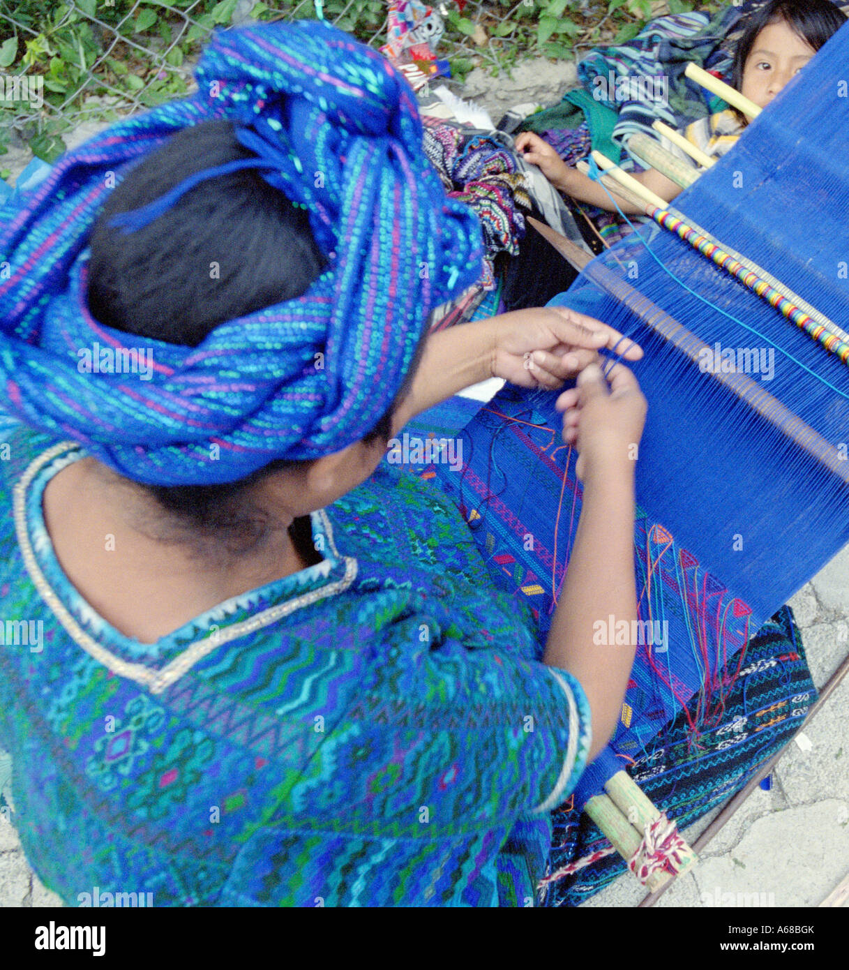 Woman Weaving on a hand loom, Santiago, Atitlan, Guatemala - Stock Image