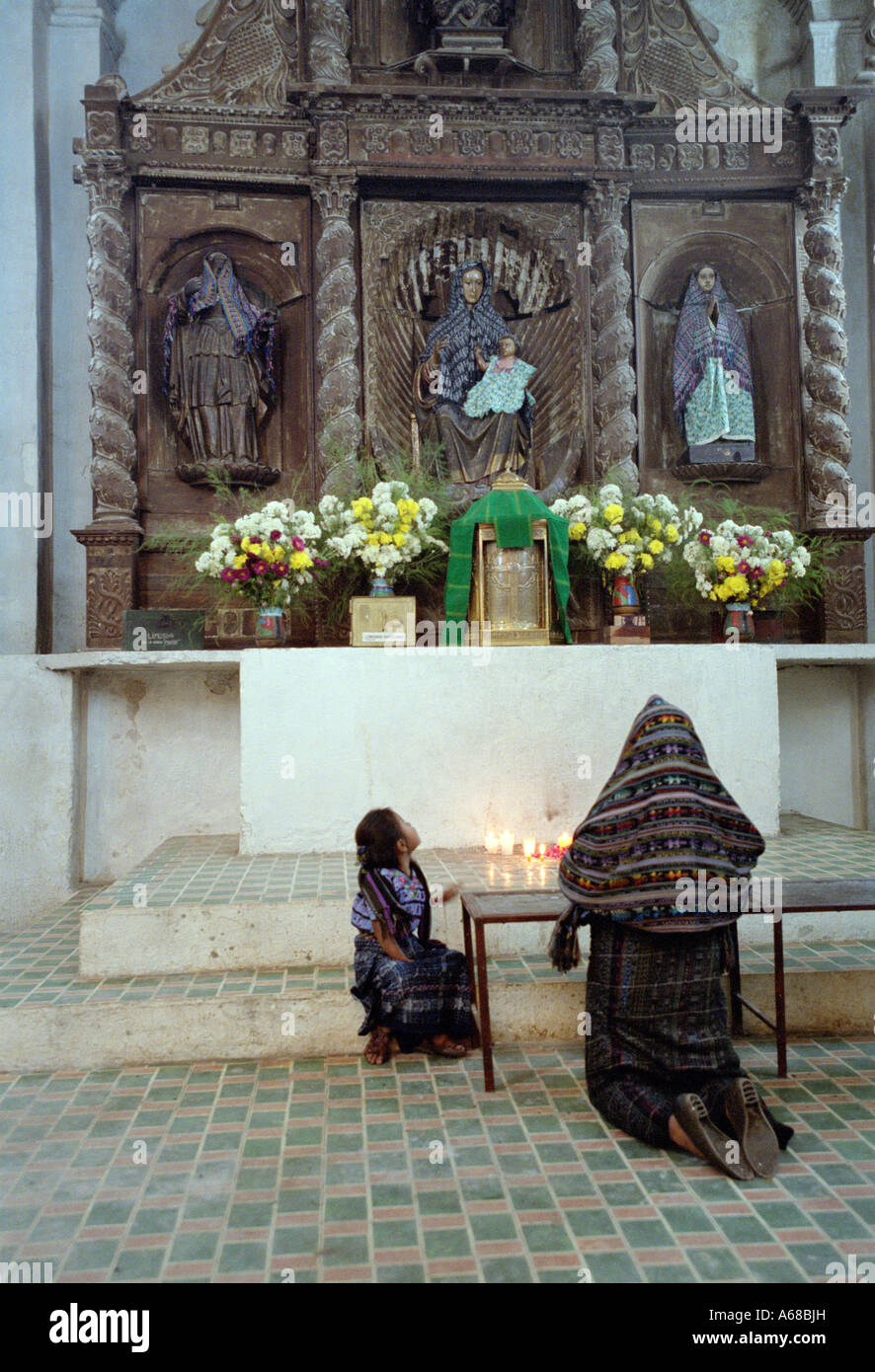 Woman & Child, Praying inside a chuch, Santiago, Atitlan, Guatemala. - Stock Image