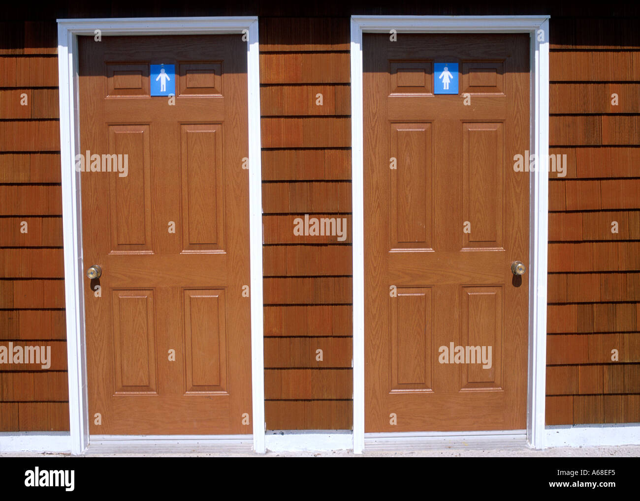 Side by side mens and womens restrooms - Stock Image
