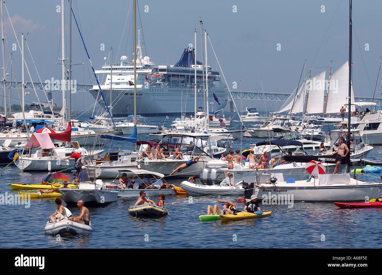 Boaters moored in Newport harbor for the Newport Folk and Jazz Festival, Rhode Island - Stock Image