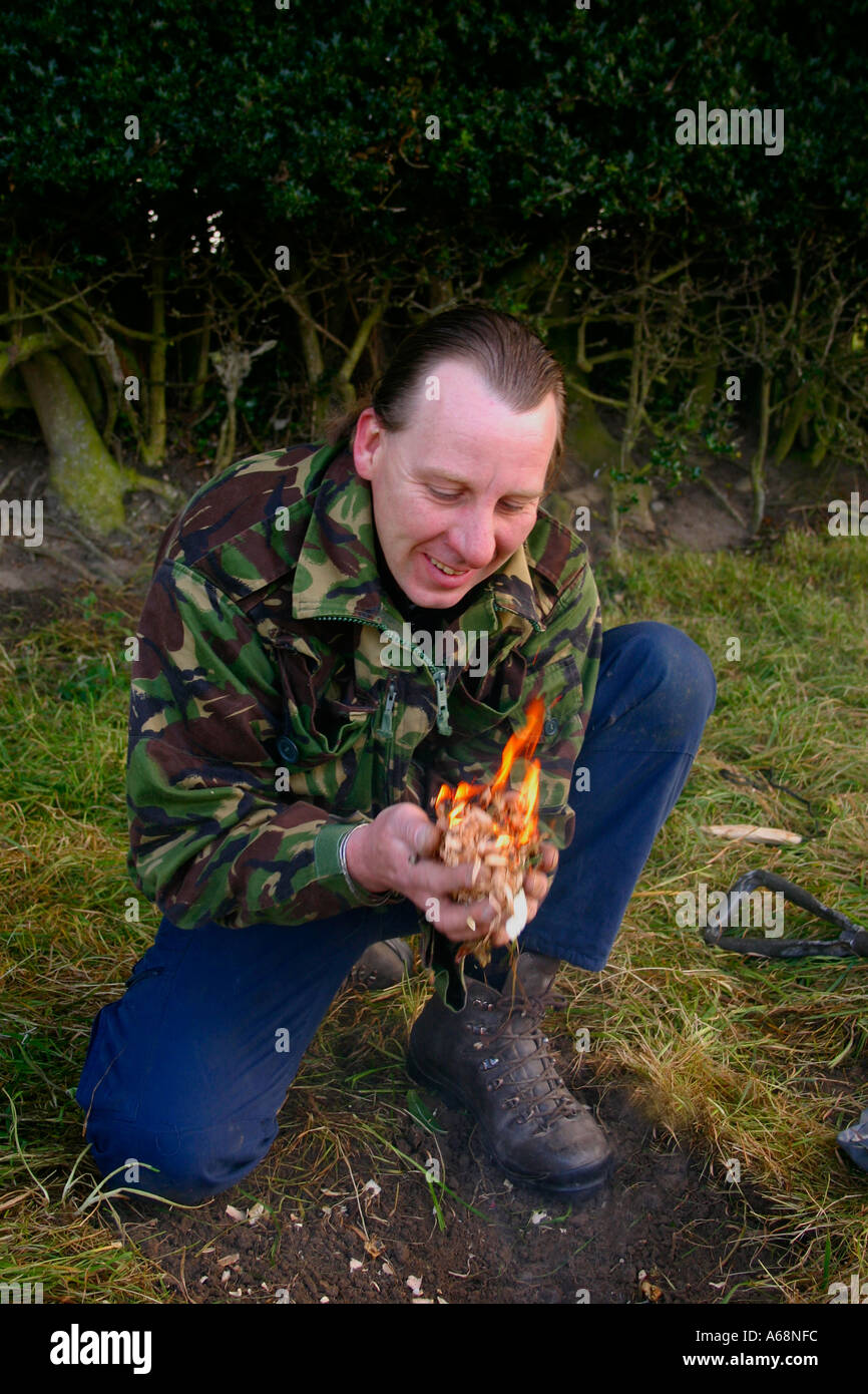Friction Fire Lighting the moment of success - Stock Image