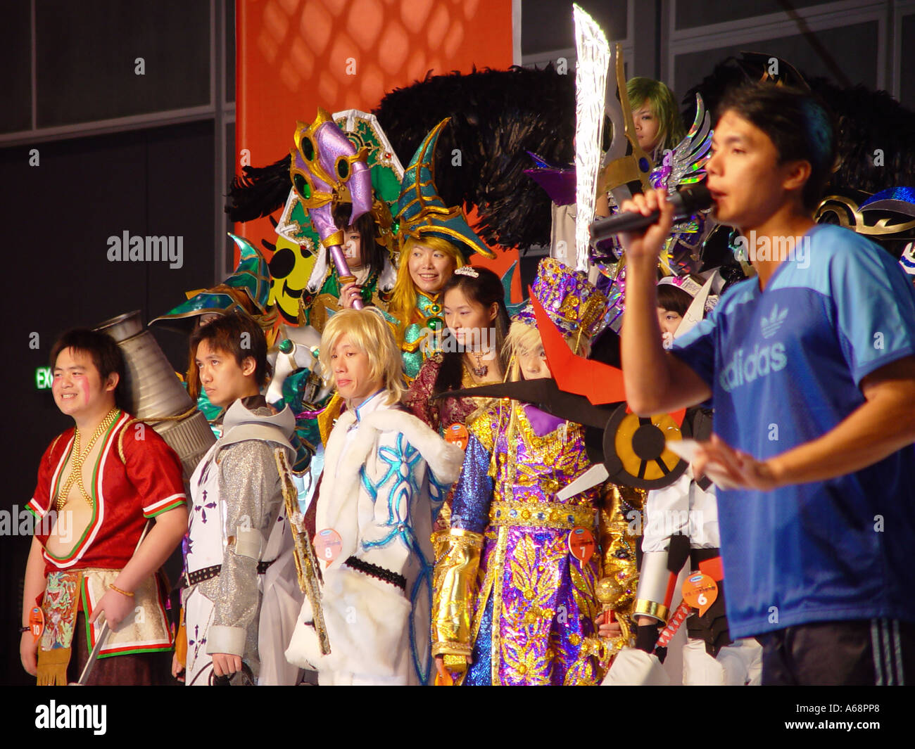 Large group of people dressed as comic book characters on stage at The Hong Kong Animax Convention 2004 - Stock Image