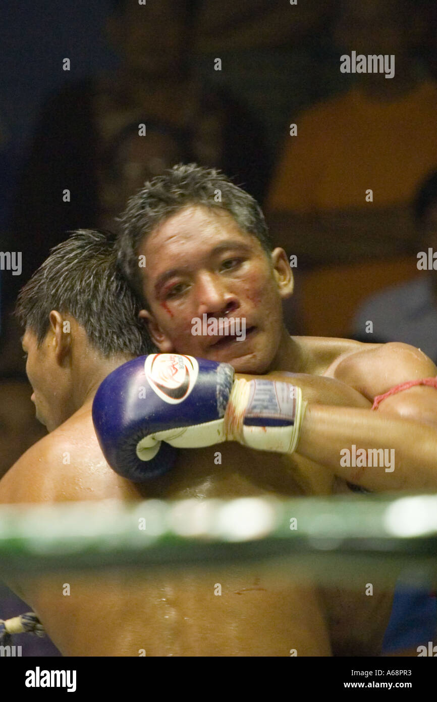 Muay Thai - Bloodied and tired Stock Photo
