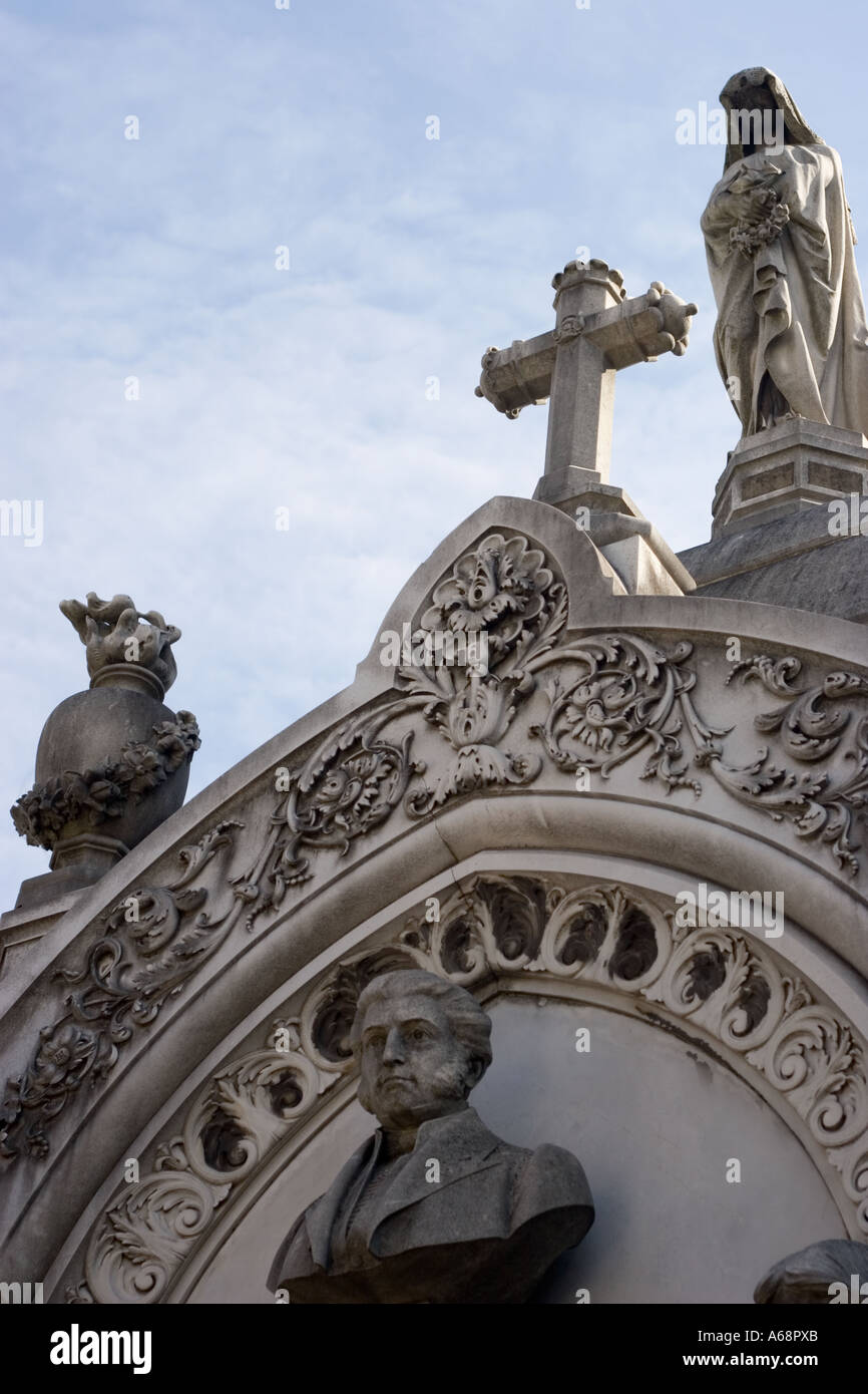 Bust, statues and Crucifix atop a tomb in Recoleta cemetary Stock Photo