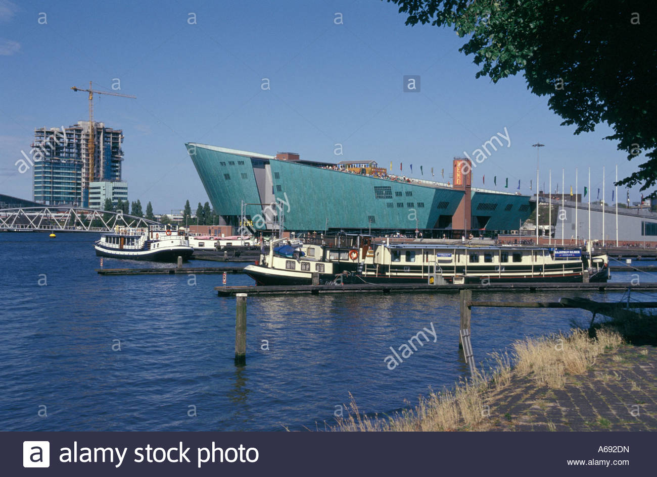 The NEMO science center by architect Renzo Piano in Amsterdam, The Netherlands - Stock Image