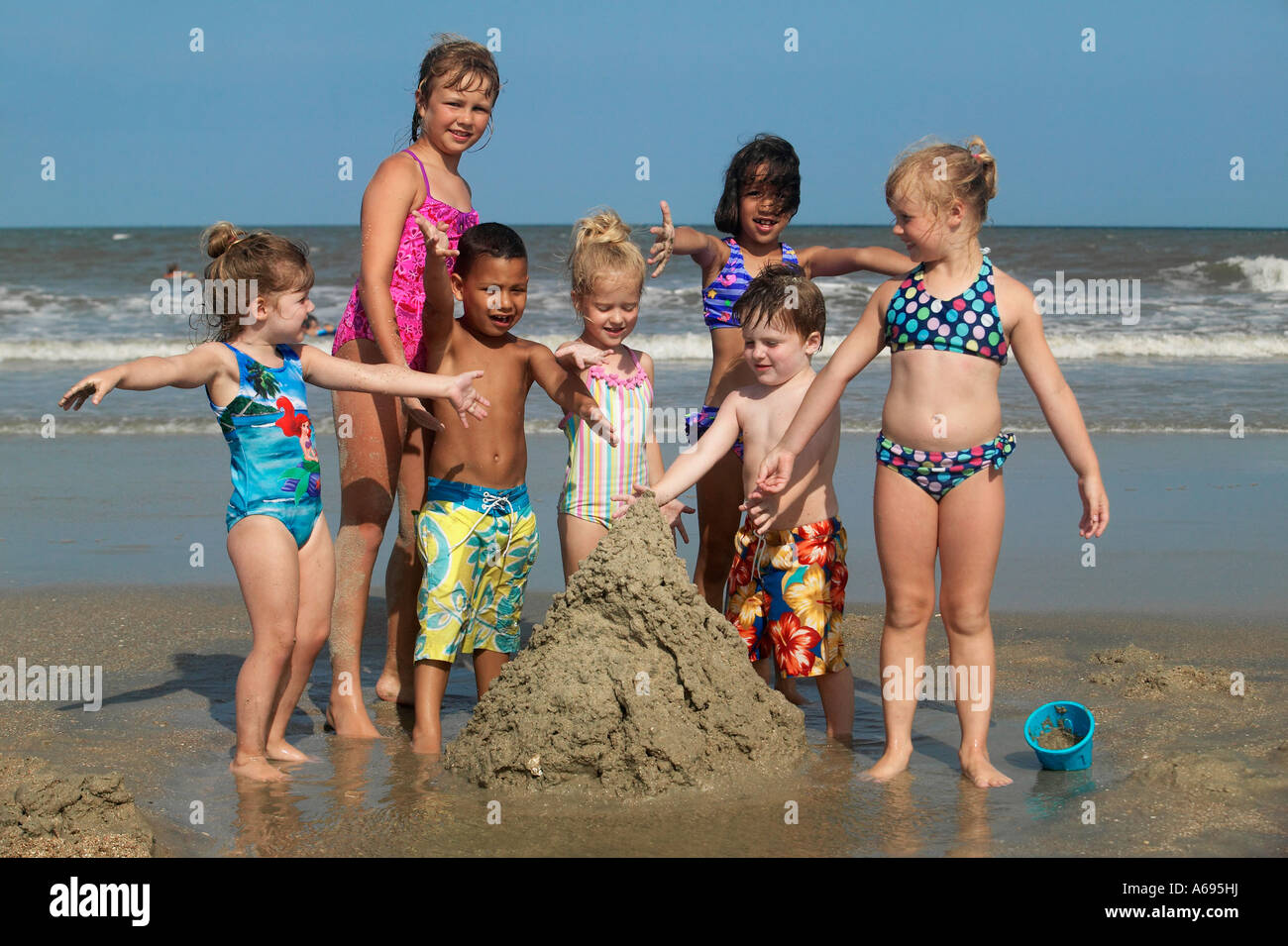 Kids At Beach Building A Sand Castle Stock Photo 11501597
