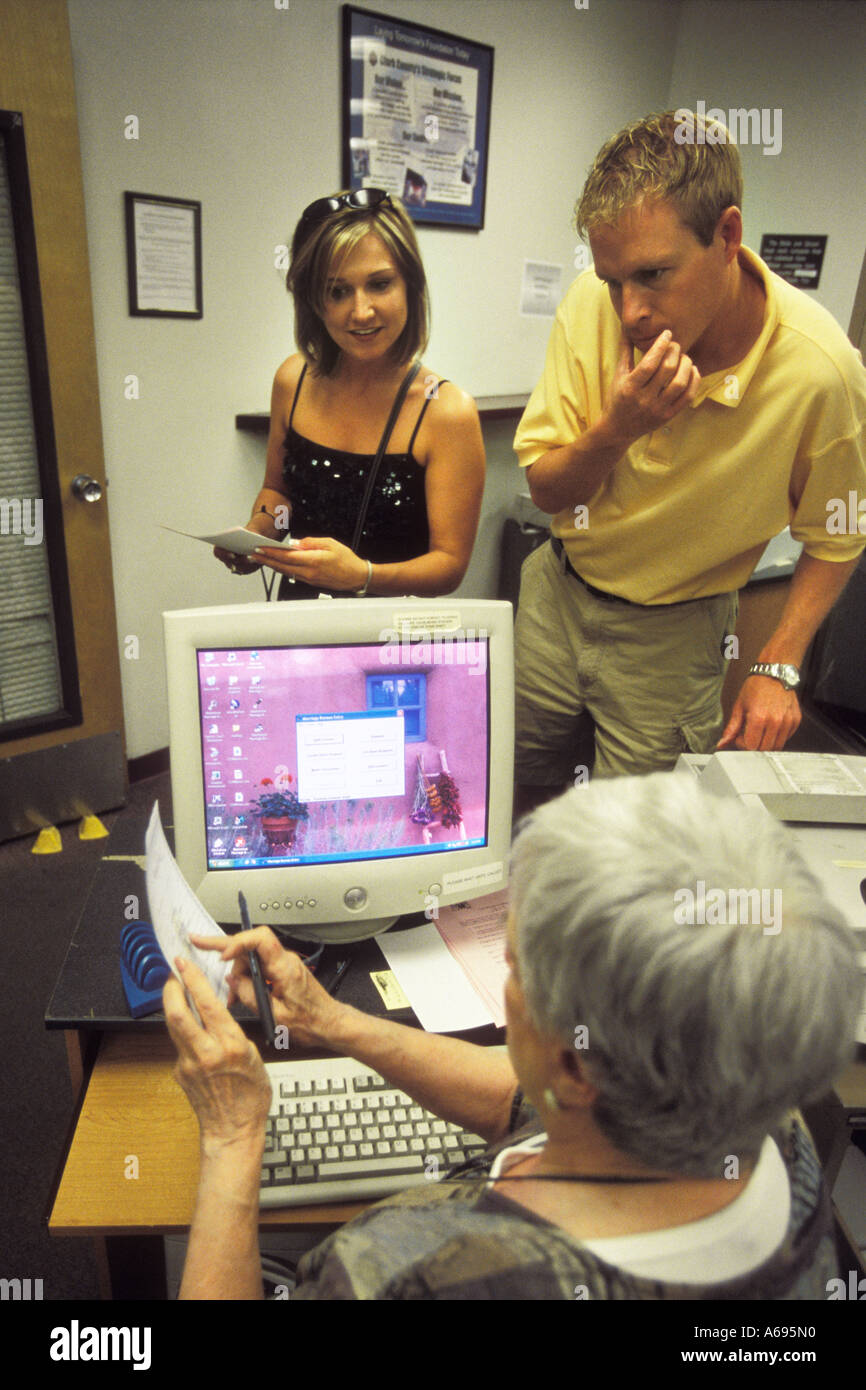 A Couple Get Their Marriage Certificate At The Clark County Stock