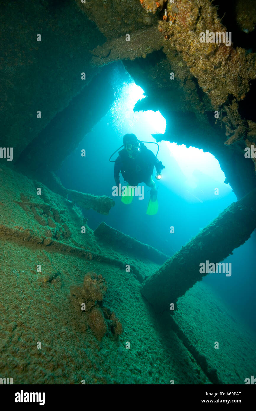 Scuba diver on the wreck of the Antilles also known as the Ghost Ship Aruba Netherlands Antilles - Stock Image
