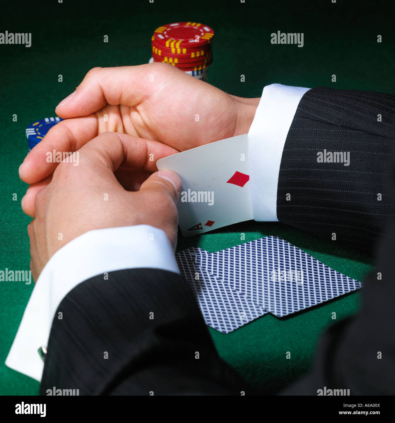 a cheat removes cards from his sleeve - Stock Image