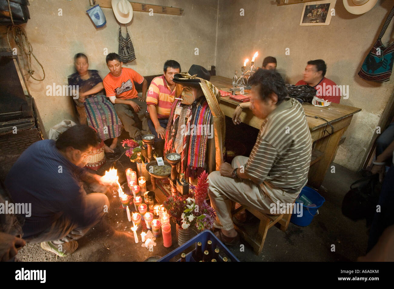 Maximon offerings of money cigarettes rum Santiago Atitlan Guatemala - Stock Image