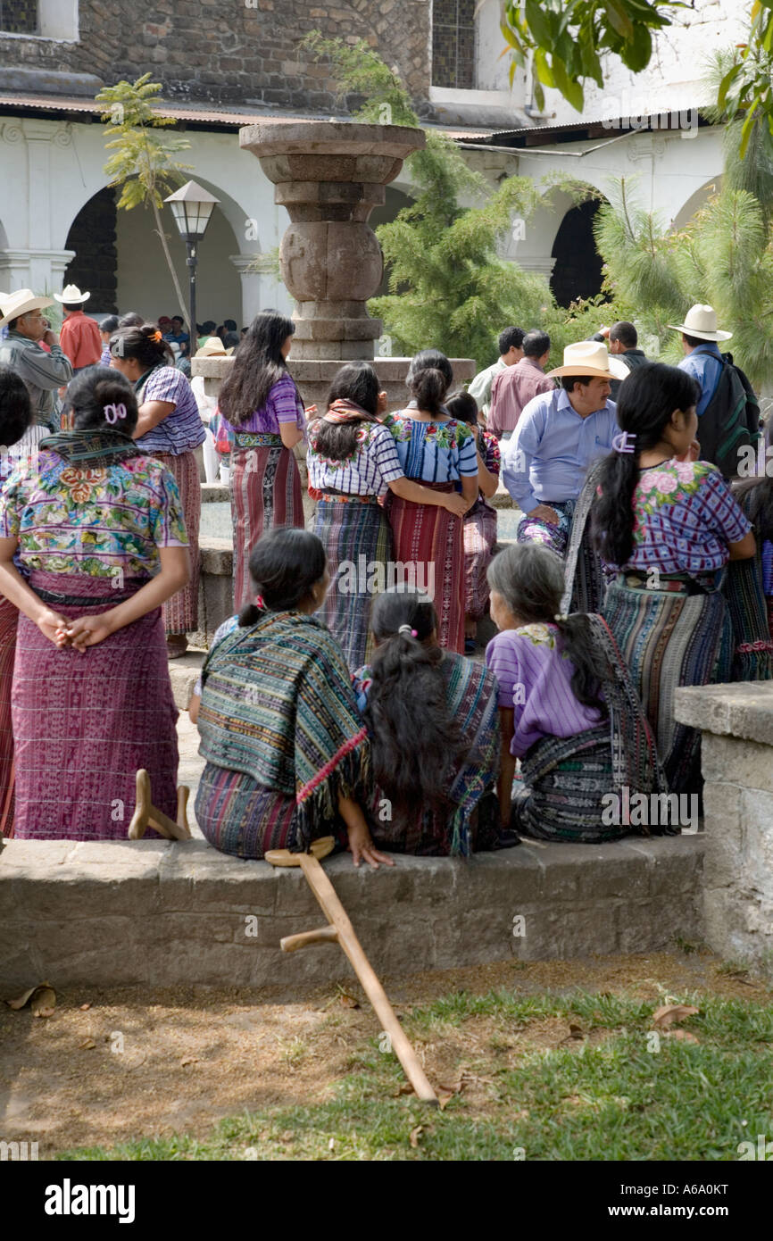 Women gather in church courtyard Santiago Atitlan Guatemala - Stock Image