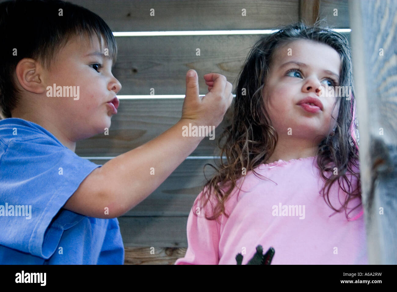 Two 3 year olds in conversation in play house. St Paul Minnesota USA - Stock Image