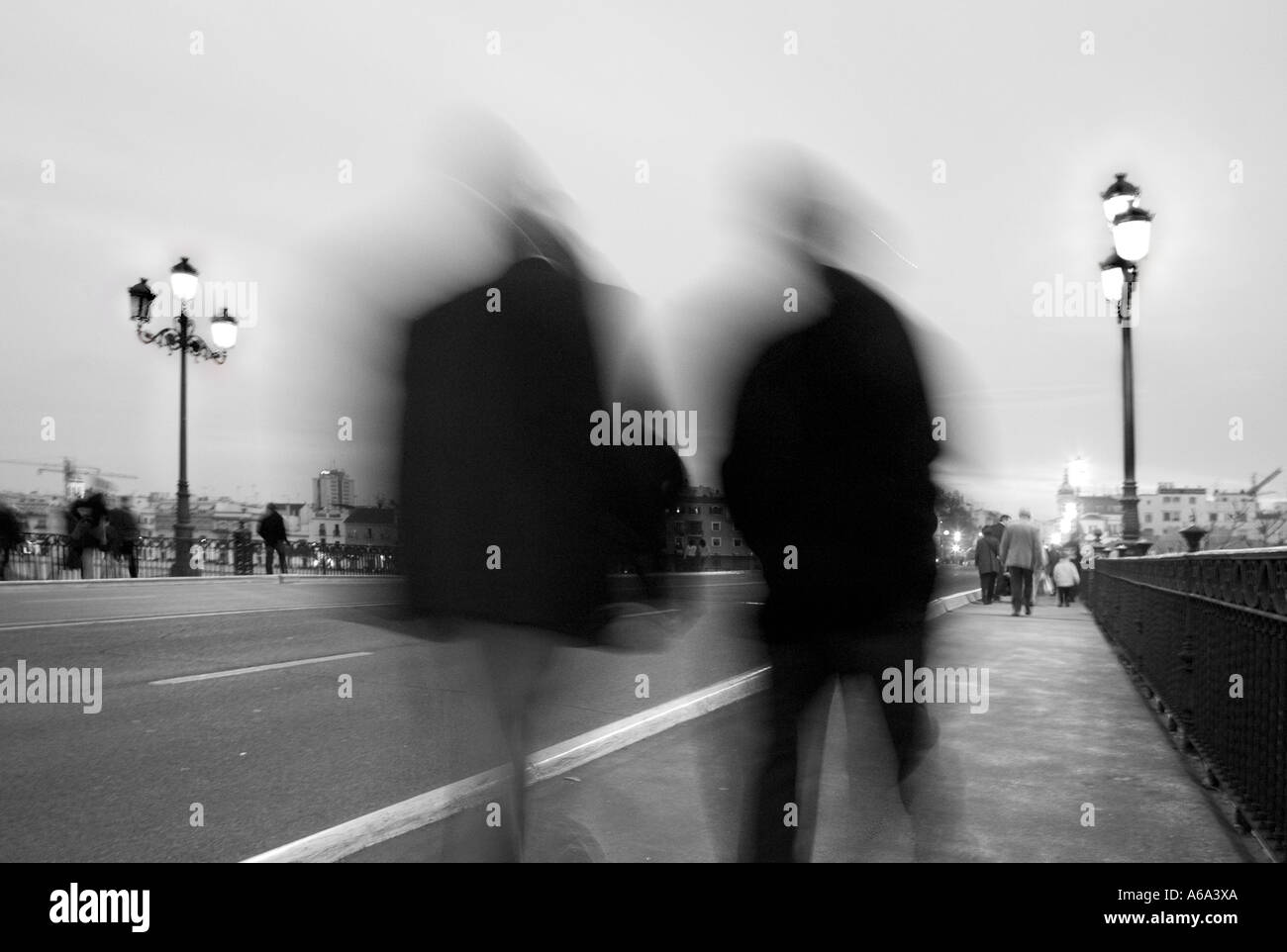 People walking on street at dusk, Seville, Spain - Stock Image