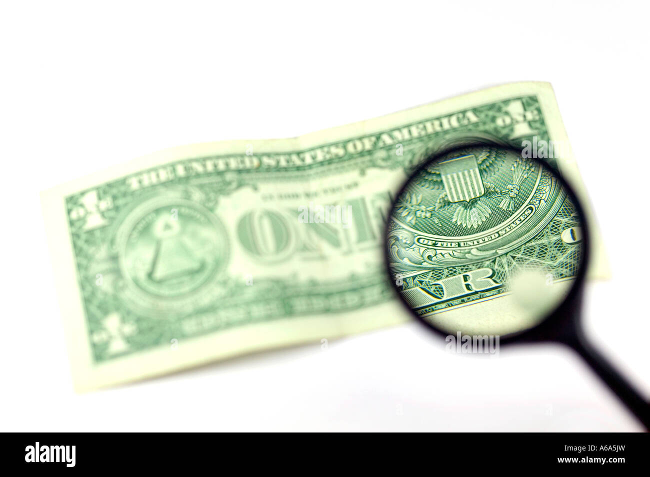 View through a magnifying glass the back of a one dollar note isolated on white - Stock Image