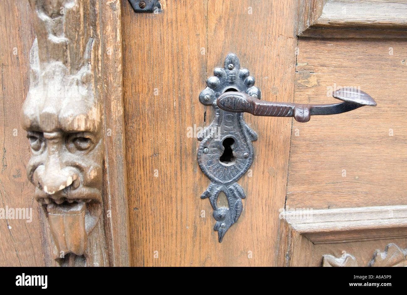 Baroque wrought iron door handle and wooden door frame carved head ...