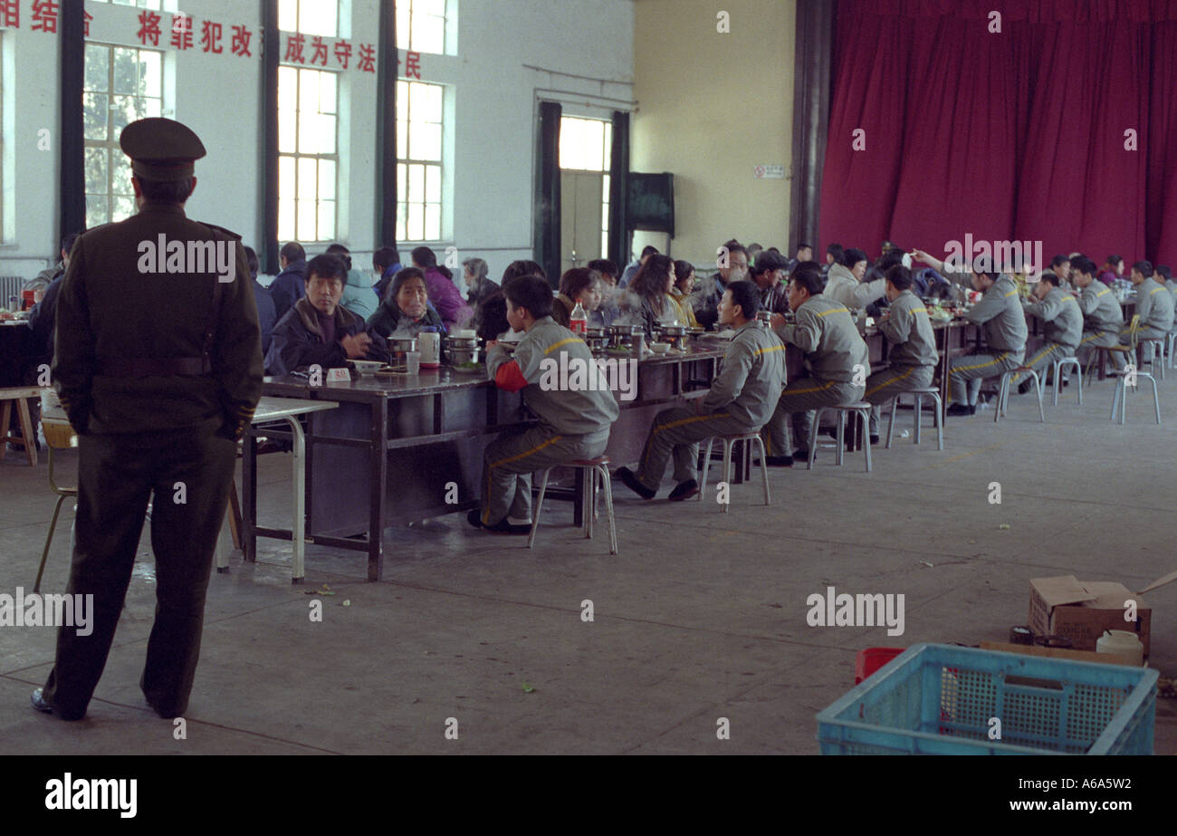 Inmates at a young offenders correctional institute eat with visiting family members in the mess hall of the jail. 20-JAN-00 - Stock Image
