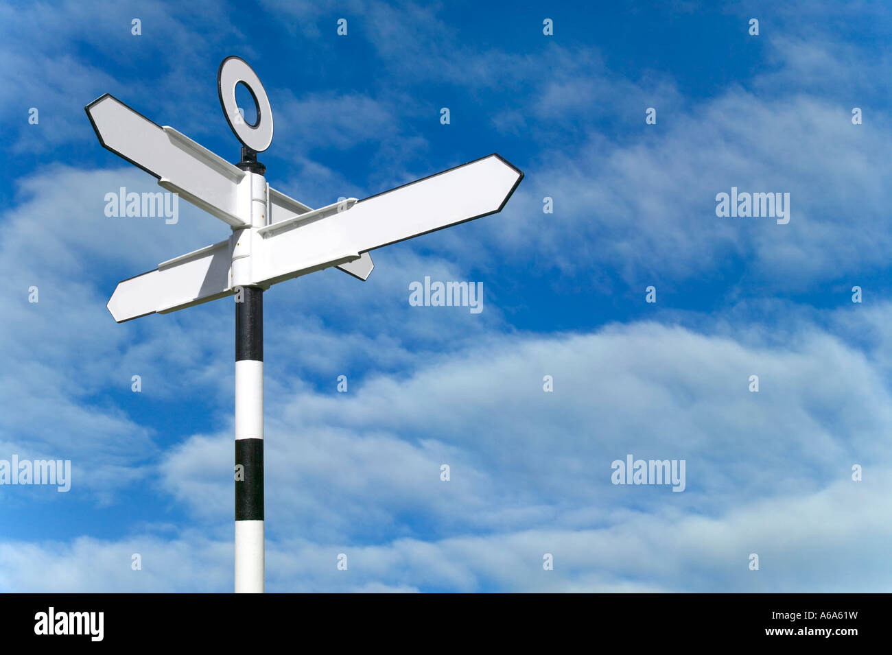 Blank road sign against a blue sky background - Stock Image