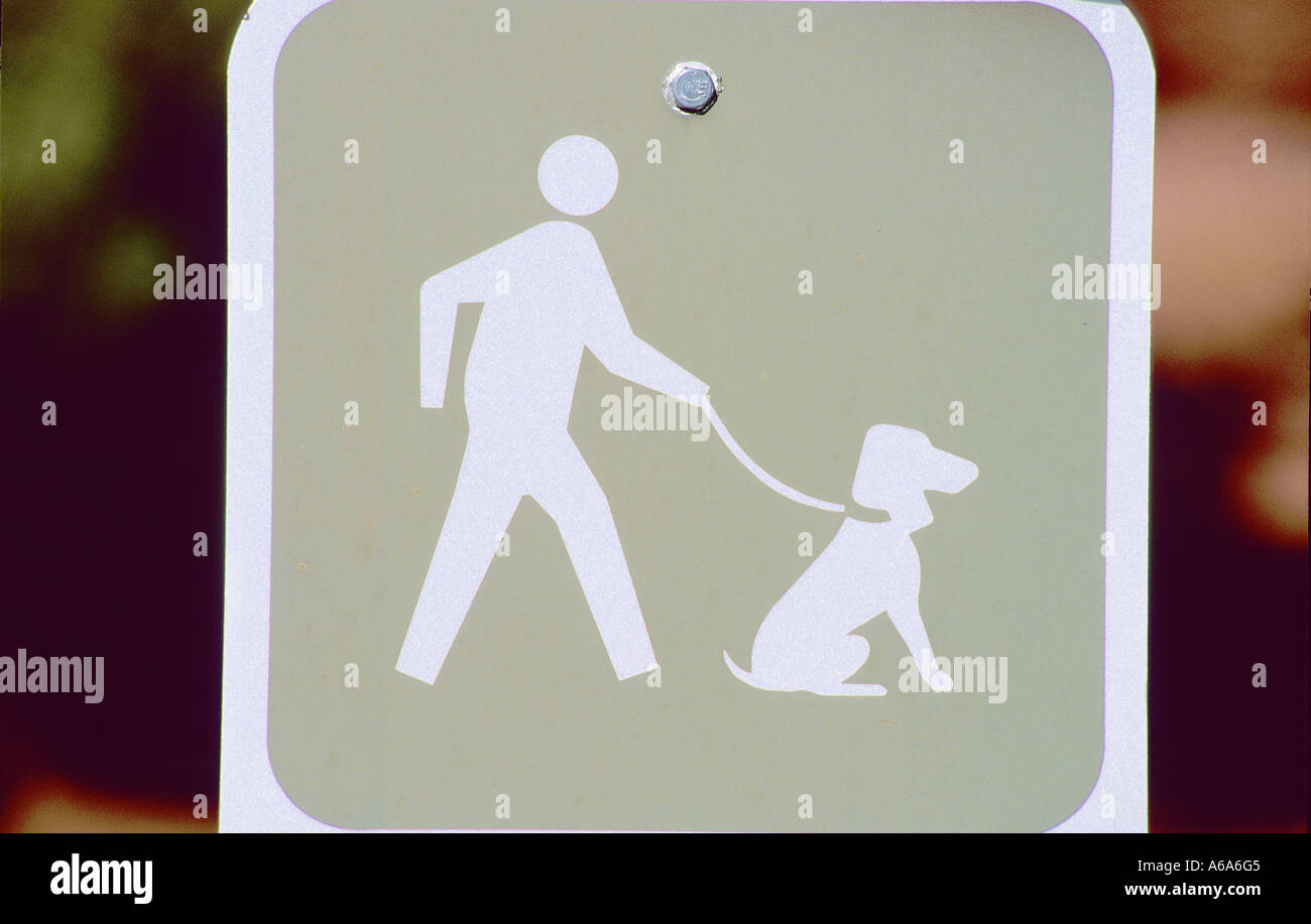 Graphical sign of man walking dog - Stock Image
