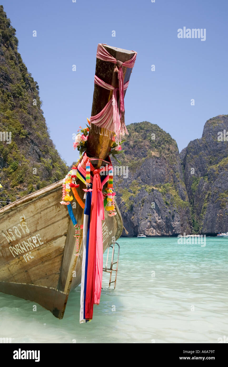 Prows of longtail boats or long tailed boat, with Buddhist garlands, Ko Phi-Phi Don island, Krabi Province, Thailand, - Stock Image