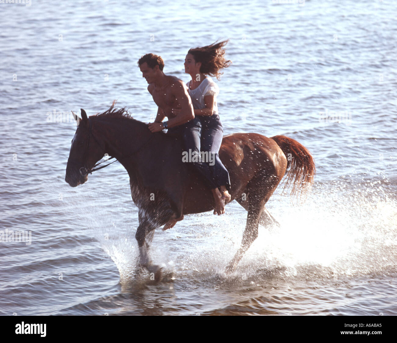 Couple Riding Horse In Shallow Lake Stock Photo Alamy