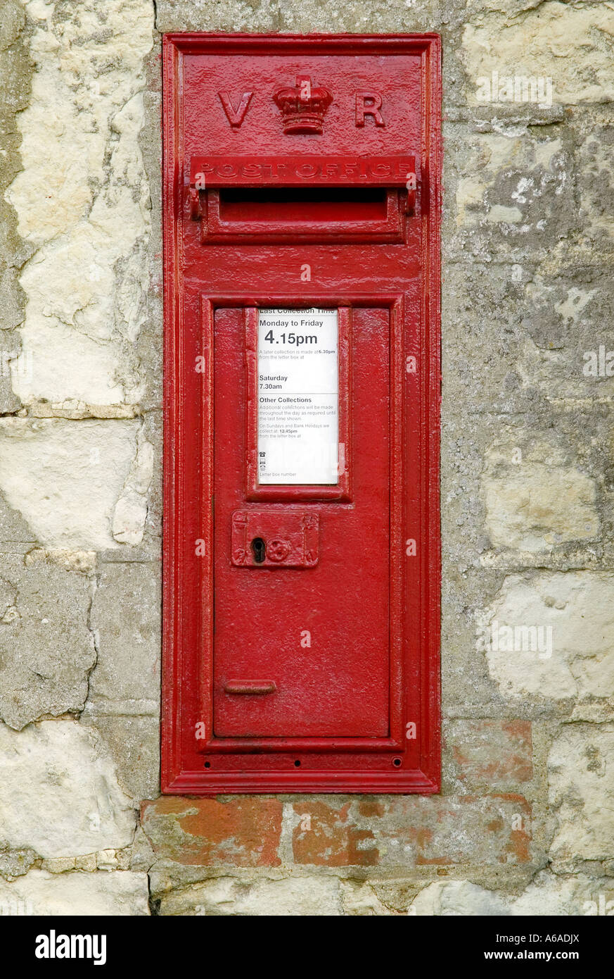 Rare English Victorian Mail Box still being used in a small village Blank spaces for your own text Stock Photo