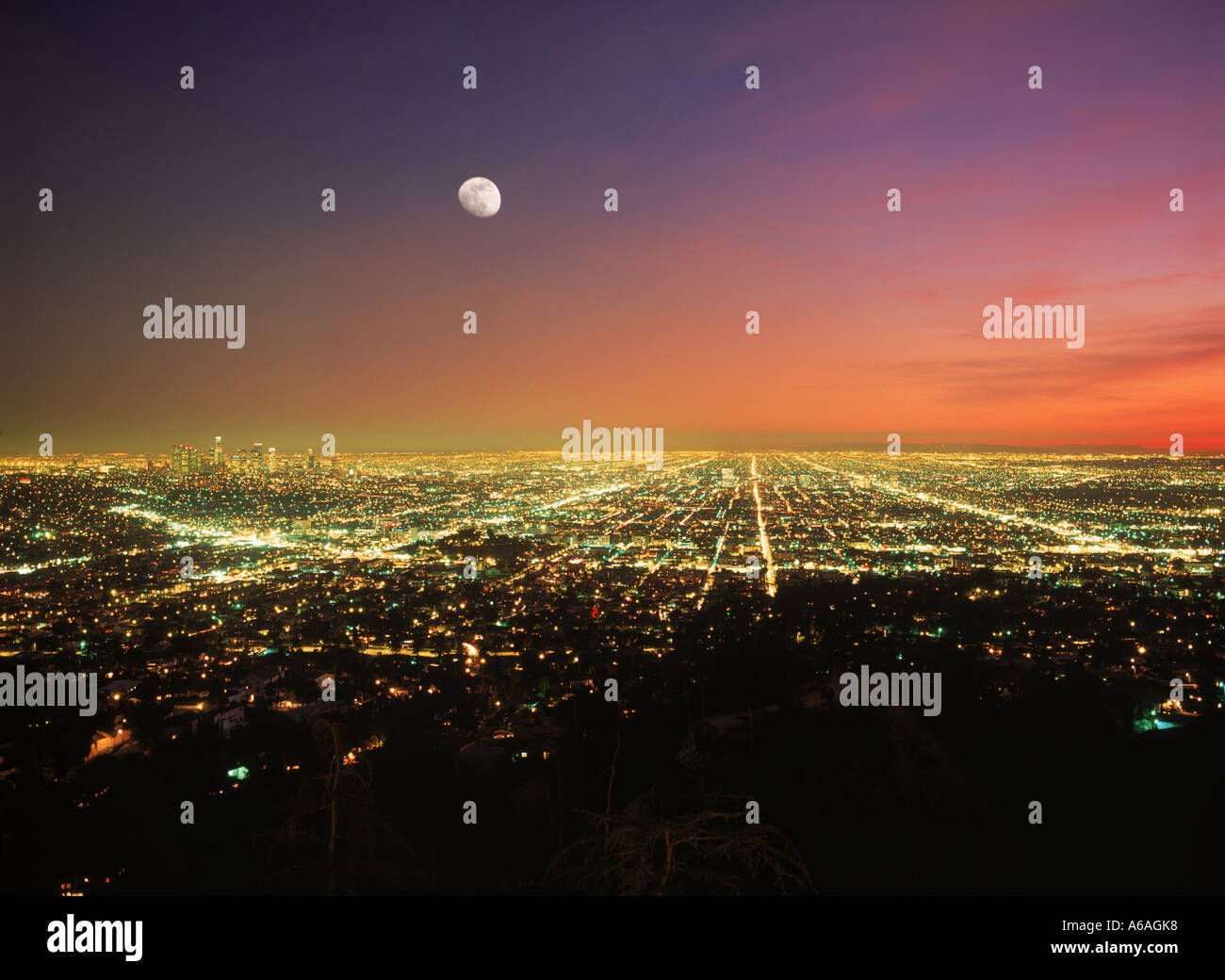 Los Angeles urban sprawl  under rising moon at dusk from Griffith Park Observatory - Stock Image