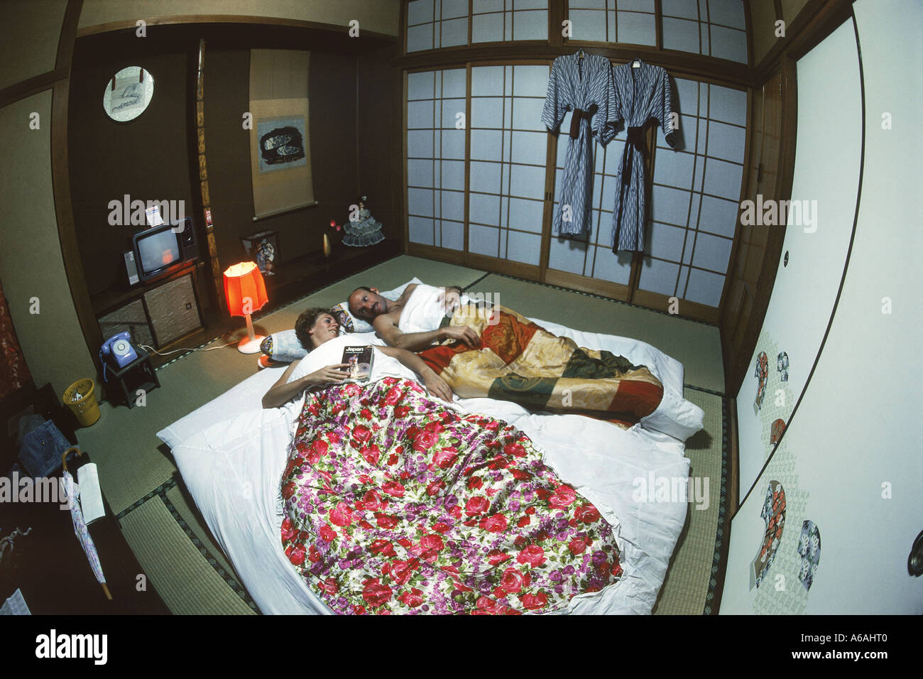 couple sleeping on futon in typical japanese home or