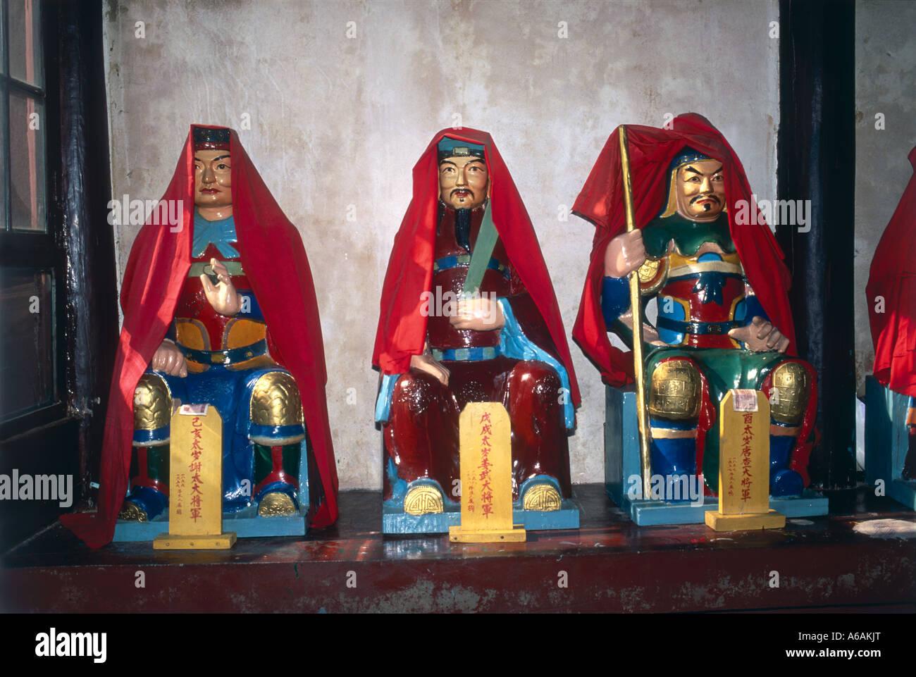 China, Hubei, Wuhan, Changchun Guan, colorful Daoist figurines in temple - Stock Image