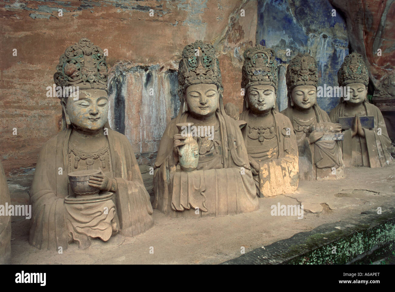 China, Sichuan, Dazu, Baoding Shan, Cave 11, Reclining Buddha, life-like busts of officials donors in meditation - Stock Image