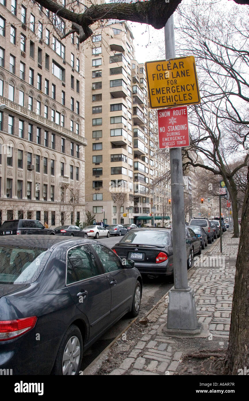 Clear Fire Lane for emergency vehicles and Snow route No standing during emergency vehicles towed signs - Stock Image