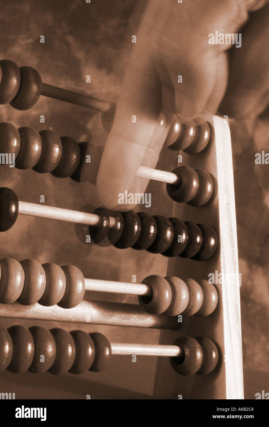 moving finger counting on an abacus - Stock Image