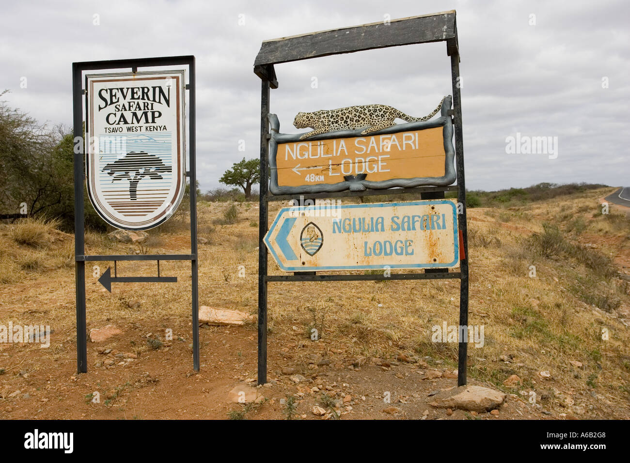 Tour lodge signboards at entrance gate to Tsavo National Park West Kenya East Africa - Stock Image