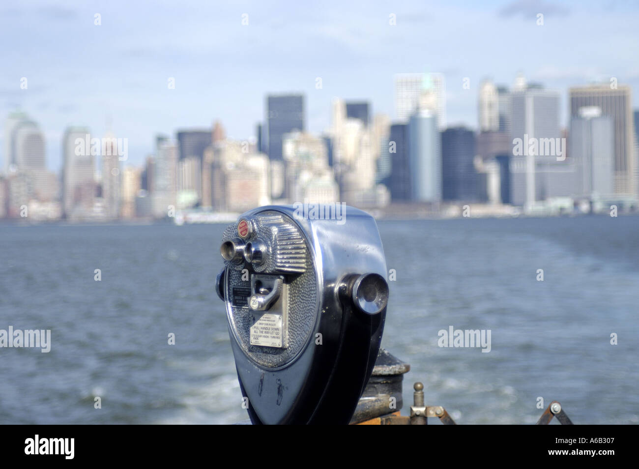 Binoculars overlooking New York City skyline from across the East River. Stock Photo
