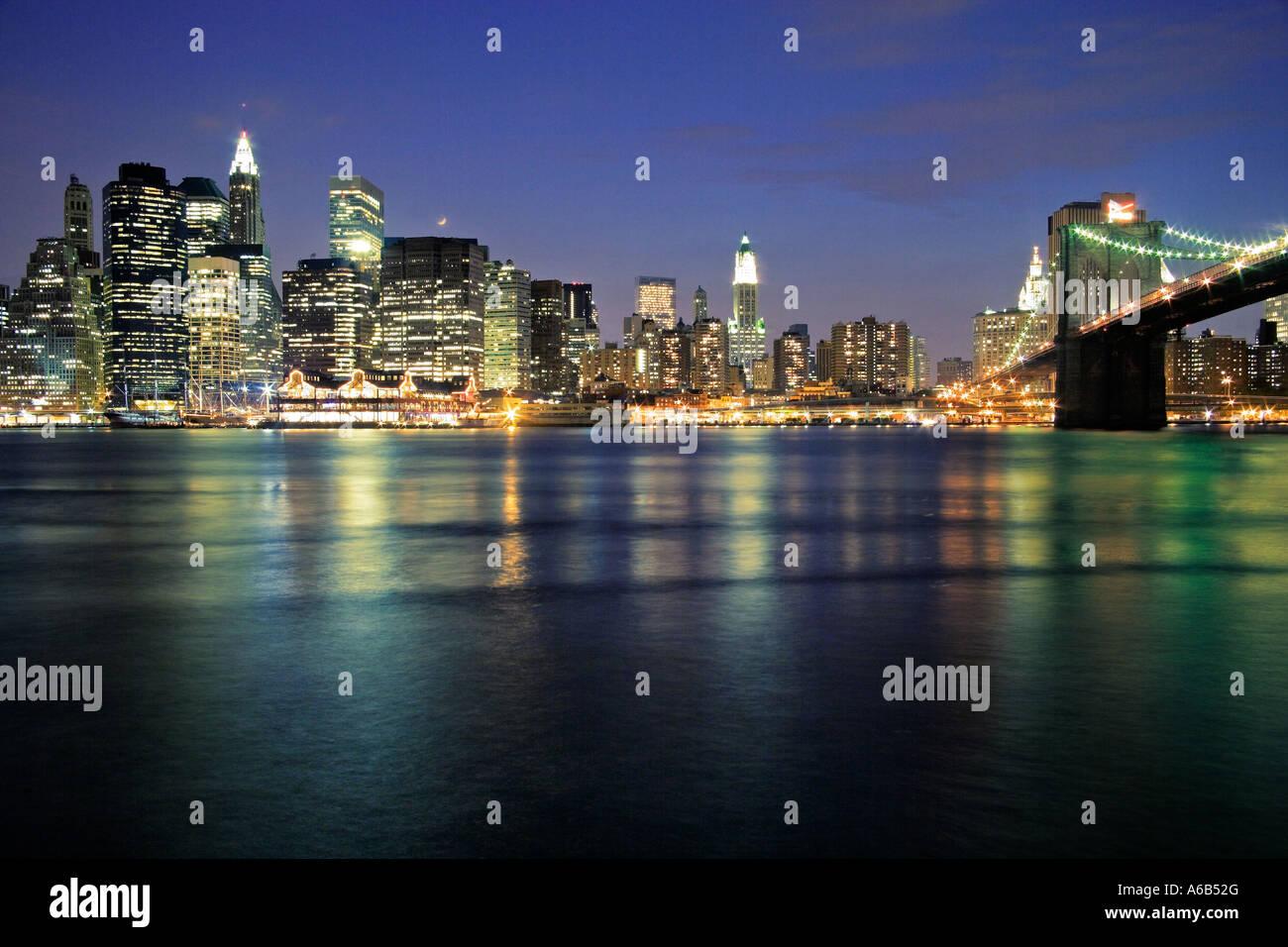 skyline of Manhattan by night twilight Financial District NYC New York City - Stock Image