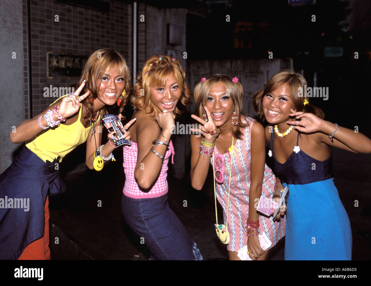 Four Girls Dressed In Ganguro Style Fashion Making Faces For The