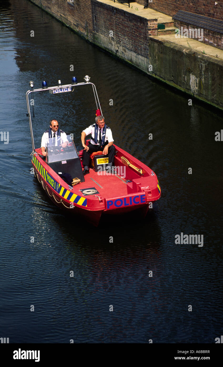A police boat patrolling the canals of birmingham behind the international convention center during the 1998 g8 Stock Photo
