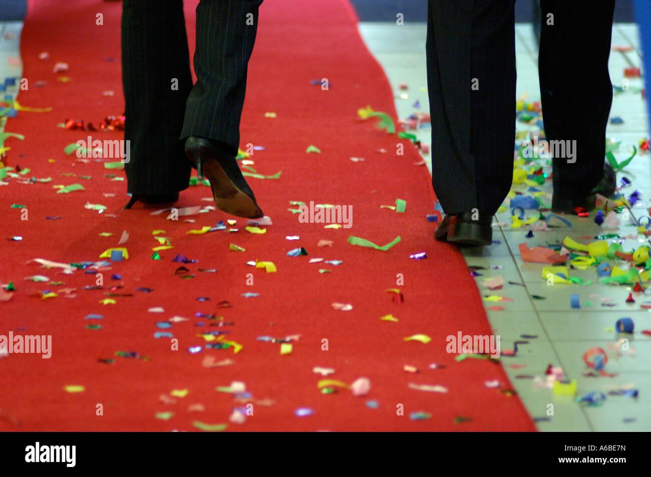 Business people walking on red carpet after celebration of opening London UK