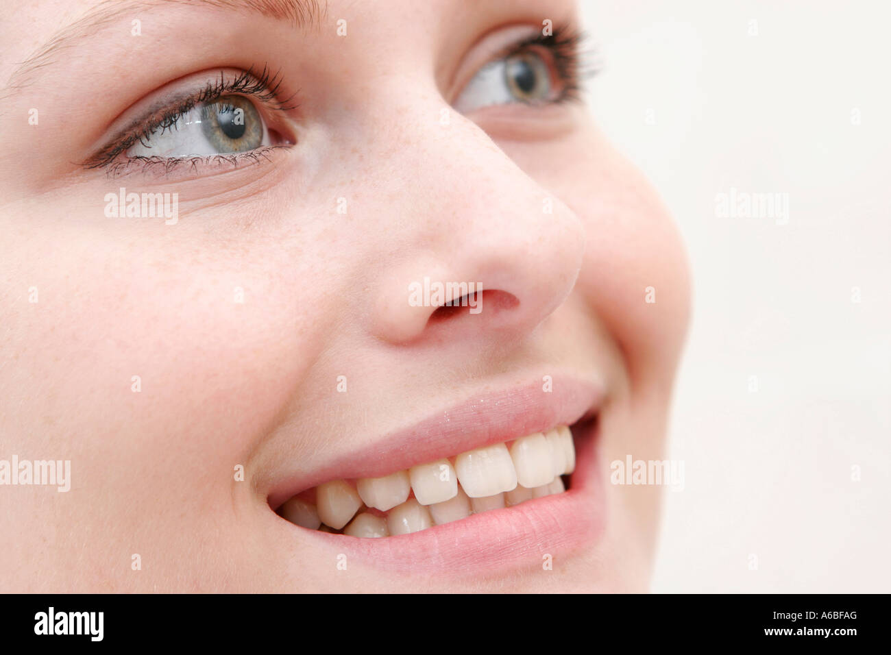 woman smiling in close up, teeth showing Stock Photo