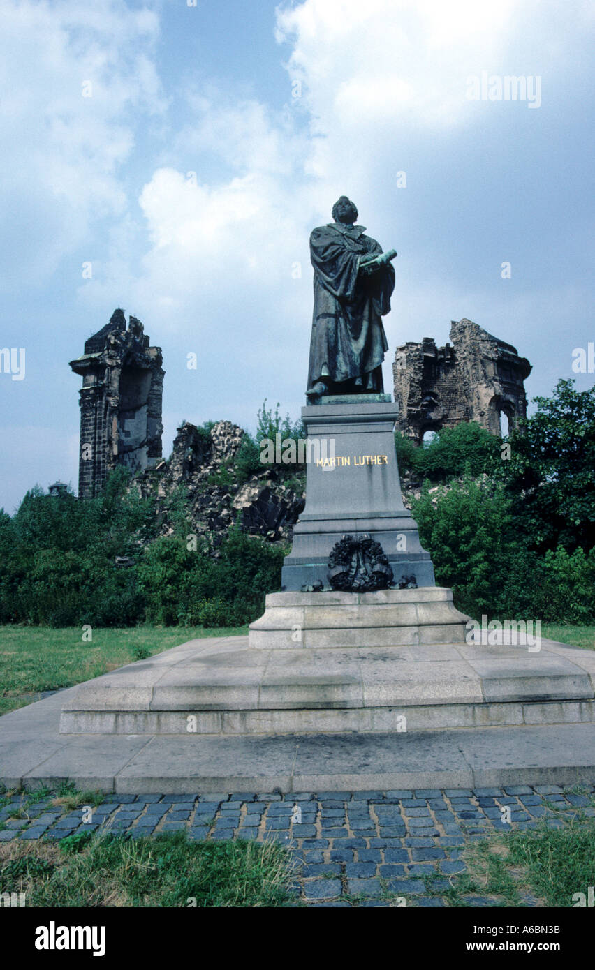 Pre reconstruction photo of statue of Martin Luther in front of the rubble of the Frauenkirche in Dresden, East Stock Photo