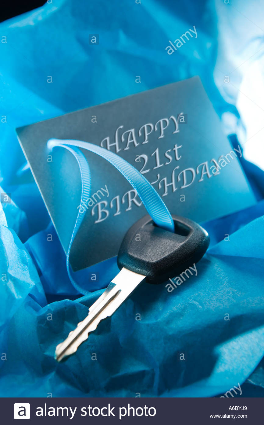 Car key on gift tag  saying Happy 21st Birthday - Stock Image