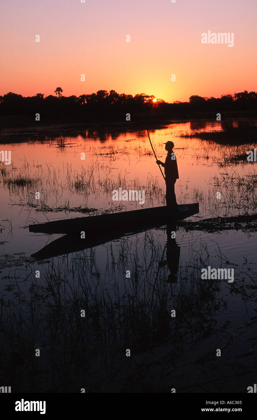 Botswana people Bayei mokoro poler at sunset in the Okovango Delta Okovango Botswana - Stock Image
