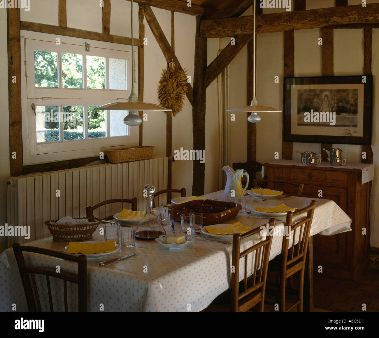 Double Pendant Lights Over Table In Country Diningroom With Beamed Stock Photo Alamy