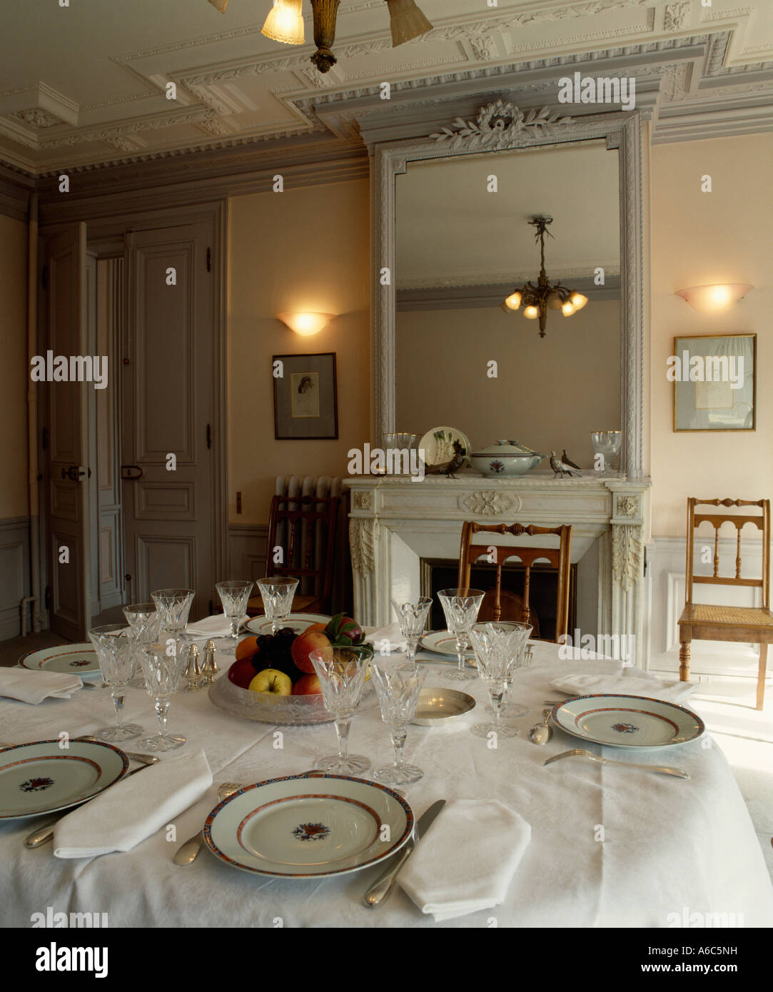 White Linen Cloth And Napkins With Place Settings On Dining Table In - Dining room table place settings