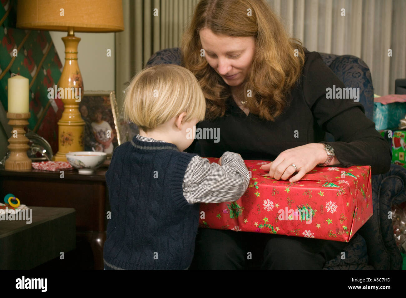 Christmas Gifts For Mom From Son.Mom And Son Opening Christmas Presents Stock Photo 6588764